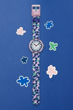 Inspired by walks in the park and lazy summer style, this stylish pink and blue watch for kids lets you give them the gift of flower power. Featuring beautiful blooms sprouting on the strap and dial, LONDON FLOWER (ZFBNP080) is a flower wrist watch with tradition and taste. Walks, Flower Power, Lazy, Swatch, Bloom, London, Inspired, Purple, Stylish