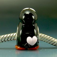For my pandora bracelet when I get it. Penguin with a heart on.