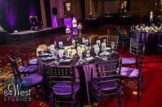 Sweet 16 or 18th Birthday party - purple linens and black chiavari chairs with purple seat covers, crystal candle chandelier inspired centerpieces. Elegant purple and silver color theme for weddings, Sweet 16s, Quinces.