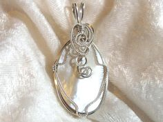 Free Shipping in U.S. - Reversible Beautiful White Iridescent Mother of Pearl Pendant hand sculpted and wire wrapped by me in the more expensive