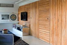 wood-wall-den - Panels of wood slats turned this way and that way to disguise several doorways. Wood Plank Walls, Rustic Wood Walls, Wood Paneling, Wood Cladding, Wood Slats, Slat Wall, Wood Design, Gym Design, Design Ideas