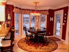 Kitchen accent wall is this color red.  Like Toile Valance against the red paint.  Gorgeous.