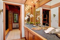 Eclectic Master Bathroom with Flat panel cabinets, Master bathroom, Flush, Hardwood floors, penny tile counters, High ceiling