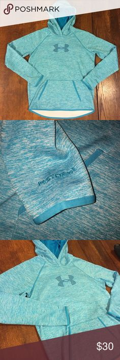 Under Armour Storm Hoodie Under Armour Storm women's hoodie- Practically brand new! Color is a marled teal/aqua with a high low hem and thumb holes!  No pilling, no wear, no stains, not even sure my daughter ever wore it.  🤦🏼♀️  ~Bundle for bigger savings or make me an OFFER!~  🛍🛍🛍💜😊😘😘💝🎁 Under Armour Tops Sweatshirts & Hoodies