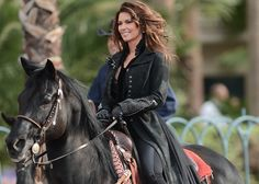 HICK CHIC: Shania Twain, riding a black horse through Las Vegas, wearing a gorgeous outfit and her wavy hair flowing in the breeze....