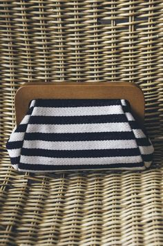 The stripes on this clutch are great for a nautical themed outfit!