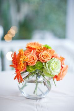 Tangerine flower & table decorations
