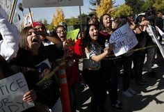 Protesters arrive at the Sonoma County Sheriff's Office after marching through Santa Rosa demanding justice for Andy Lopez Cruz