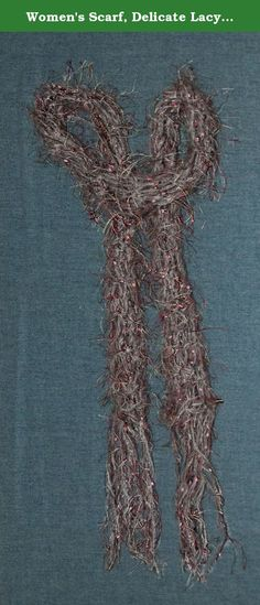 """Women's Scarf, Delicate Lacy Hand Knit Grey and Pink. Hand knit, gray and pink women's scarf. Small flecks of shimmering multiple colors throughout. Hand wash, lay flat to dry. Grey and pink cosmo Mohair yarn with rayon. Scarf measures approx. 50"""" long and 2 1/2"""" wide with 7"""" of fringe on each end. Fabulous color combination. Scarf was knit as a fashion accessory. Definitely acceptable for work or evening."""