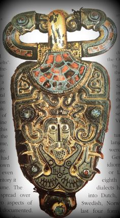 This 7th century brooch bears the insignia of the battlefield: two birds (possibly eagles or crows) decorate the top of the brooch, while a warlike face dominates its centre. (Saga of the Norsemen: Viking and German Myth; Loren Auerbach & Jacqueline Simpson; London 1997, pg 8)