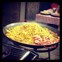 Sample a traditional Paella Valenciana at Borough Market in London.