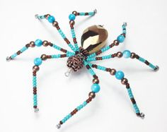 Winslow - turquoise and copper glass beaded spider goth sun catcher - Halloween decoration - Christmas ornament by MossandStoneStudio on Etsy Mirror Spider, Wire Spider, Pet Spider, Spider Art, Beaded Crafts, Beaded Ornaments, Jewelry Crafts, Christmas Spider, Christmas Ornament