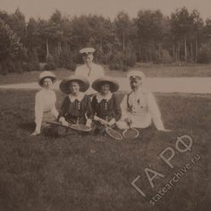 Grand Duchesses Olga and Tatiana with a friend and officers, ca. 1912. Credit: Russian State Archive