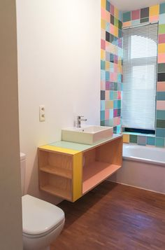 Atelier Antipode | bathroom cabinet in plywood, OSB and colorful HPL laminate