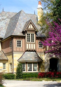 Exterior garden view of a Normandy French House in Dallas, TX. Traditional French architecture by Richard Drummond Davis Architects.