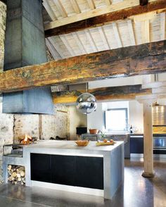 Rustic Modern: Barn Kitchen // concrete countertops // wood burning cooking