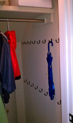 Add lots of hooks in the coat closet/understairs cupboard and a rail if to maximise your space.