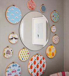 Place bright fabrics in embroidery hoops for #nursery art that's done in 5 minutes.