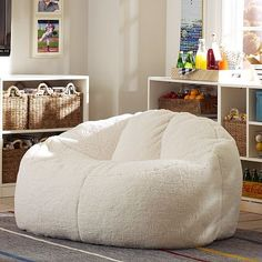 This would fit beautifully between two tall library shelves! Ivory Sherpa Cloud Couch #potterybarnteen