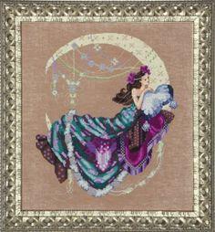 Mirabilia Moon Flowers - Cross Stitch Pattern. Model stitched on 32 Ct. Milk Chocolate linen with DMC floss, Kreinik #4 Braid, Caron Waterlilies and Mill Hill b