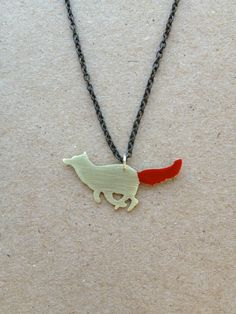 I'd love a brass greyhound with a little red collar... Think I might see if she can do a custom order for me some time :)    Running Fox with Red Tail Necklace. $28.00, via Etsy.