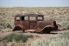 Route 66 - Abandoned car in Arizona desert.