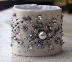 Wedding Bridal Wrist Cuff made with white satin, pearls, crystals, rhinestones, glass buttons and metallic thread by lesjardinsdevie on Etsy Fabric Bracelets, Thread Bangles, Handmade Bracelets, Beaded Cuff Bracelet, Wedding Bracelet, Cuff Bracelets, Textile Jewelry, Fabric Jewelry, Bridal Cuff