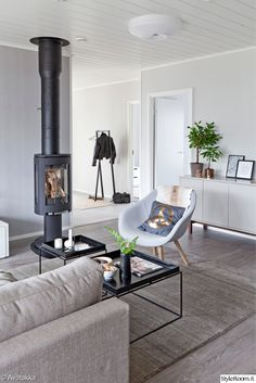 We at BROSA are in love with this Scandinavian style living room. This tub chair with the oak legs makes a beautiful feature chair. And the indoor plants compliment the neutral greys. Lounge Design, Interior Decorating, Interior Design, Living Room Interior, Living Rooms, Scandinavian Home, Fireplace Mantels, Interior And Exterior, Modern