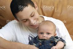 Big brother playing with cute baby royalty-free stock photo