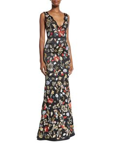 Alice + Olivia satin gown with floral embroidery. Scalloped V neckline and back. Sleeveless; tapered straps. Princess seams on bodice. Trumpet silhouette. Floor-sweeping hem. Hidden back zip. Nylon; e