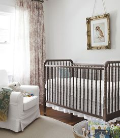 Country Living: Bargains abound in the twins' nursery: a Jenny Lind-style crib by DaVinci for Target, an Ikea chair, and an Albrecht Durer owl print from allposters.com. The toile drapes are by Curtainworks. I think this is such a cute simple baby room!