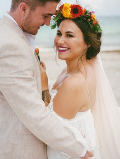 15 Different Ways to Style a Veil With a Flower Crown - Throwing a bohemian beach wedding? Toss up those long locks in a loose bun and top off your hairstyle with a bright, colorful flower crown against an off-white veil. Bohemian Beach Wedding, Beach Wedding Flowers, Beach Wedding Hair, Wedding Veils, Wedding Beauty, Bridal Hair, Dream Wedding, Wedding Shit, Star Wedding