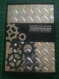 Spellbinders foil paper in metal tones. The cogs are also cut out of the foil paper and are a combination of Tim Holtz mini cogs and Stampin Up cog punch.