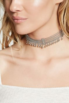 A high-polish chain choker featuring matchsticks etched with an ornate design, a beaded trim, and a lobster clasp closure.