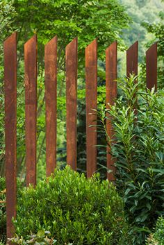 I would like to create this fence. It makes the garden a space, but isn't closed out. You can still see the neighbor, but gives a…