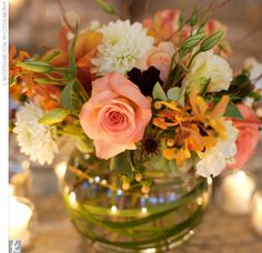nice airy centerpiece -  bubble bowl filled with willow branches, cream and green hydrangeas, cream calla lilies, white dendrobium orchids, cream and peach-hued dahlias, various peach roses, and peach-hued alstroemerias