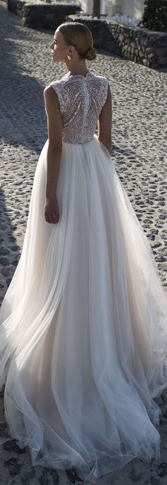 Bead back and Tulle skirt wedding gown. Stunning dress for spring