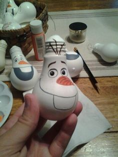 Grab those old energy-wasting incandescent light bulbs and check out these ideas for turning them into decorative ornaments.  Olaf painted light bulb