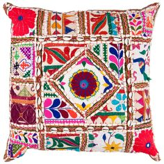 The eclectic Surya Patchwork pillow captivates with eye-catching energy. Popping against a white background, colorful motifs and shell embellishments create a truly one-of-a-kind accessory. 50% cotton/50% polyester with lace accents; Shades of red, yellow, blue, green, pink, orange and purple; Includes down filler; Dry cleaning recommended.