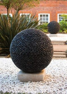 Garden Sphere in Black Stone, Slate or Glass. David Harber, UK