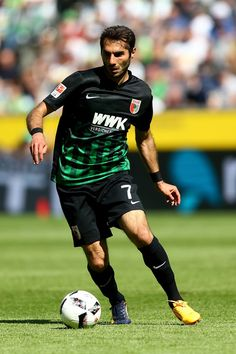 Halil Altintop of Augsburg runs with the ball during the Bundesliga match between Borussia Moenchengladbach and FC Augsburg at Borussia-Park on May 6, 2017 in Moenchengladbach, Germany.