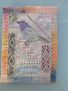 Vintage lace and linen scraps; bird gives interest!