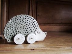 Love this - AVAILABLE IN 2 WEEKS - Ceramic Hedgehog on Wheels for Your Home - Home Decor. Who would have thought hedgehogs would be so hip? I've been collecting Christmas ornaments for years.