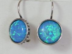 Sterling silver rugged linings opal earrings . You better order this unique piece right way, look at our feedback score - people like our stuff :)