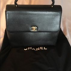 Chanel black caviar leather jumbo Kelly Bag The rare & versatile Chanel Black Caviar Leather Jumbo Kelly Bag. Large case can serve as a top handle tote or an ultra-stylish briefcase.The Kelly features gorgeous caviar leather & a CC turnlock. Interior is lined w/luxurious black lambskin w/ 2 large slot pockets. Almost no signs of wear. The goldtone CC turn-lock has a couple slight surface scratches. The interior is clean & in great condition. Comes w/ Chanel Dust bag & authentication card…