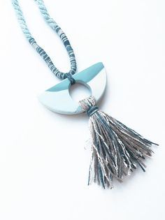 Polymer clay pendant with mixed fibre tassel