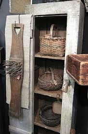 Old Primitive Cupboard...filled with old baskets.