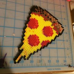 Drippy pizza slice perler beads by soberandawesome
