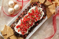 Olives and sun-dried tomatoes get a whirl in the food processor for this tasty tapenade. Top with Parm and fresh tomatoes to keep guests dipping.