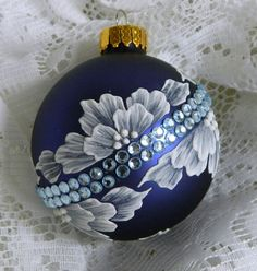 Blue MUD Ornament with Flowers and Blue Rhinestone Bling. $20.00, via Etsy.